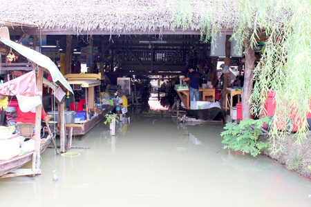 ayothaya: AYUTTHAYA, THAILAND - JANUARY 6 : Unidentified merchants are selling food in Ayothaya Floating Market on January 6, 2013 at Ayutthaya, Thailand.
