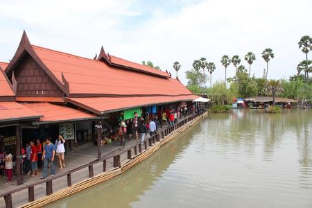 AYUTTHAYA, THAILAND - JANUARY 6 : Unidentified tourists are traveling to Ayothaya Floating Market on January 6, 2013 at Ayutthaya, Thailand. Stock Photo - 17356138