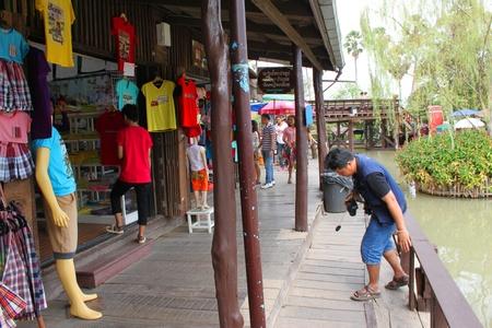 ayothaya: AYUTTHAYA, THAILAND - JANUARY 6 : Unidentified tourists are shopping at Ayothaya Floating Market on January 6, 2013 at Ayutthaya, Thailand.
