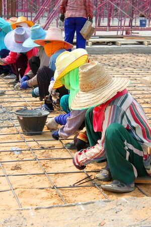 MUANG, BURIRAM - JANUARY 26 : Unidentified workers are working on construction site on January 26, 2013 at Taweekit Plaza Supermarket, Muang, Buriram, Thailand. Stock Photo - 17679310