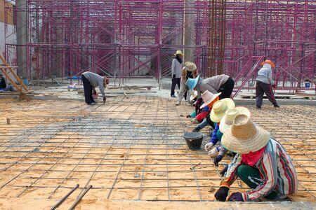 MUANG, BURIRAM - JANUARY 26 : Unidentified workers are working on construction site on January 26, 2013 at Taweekit Plaza Supermarket, Muang, Buriram, Thailand. Stock Photo - 17712737