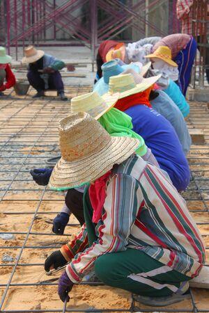 MUANG, BURIRAM - JANUARY 26 : Unidentified workers are working on construction site on January 26, 2013 at Taweekit Plaza Supermarket, Muang, Buriram, Thailand. Stock Photo - 17679303