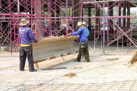 MUANG, BURIRAM - JANUARY 26 : Unidentified workers are working on construction site on January 26, 2013 at Taweekit Plaza Supermarket, Muang, Buriram, Thailand. Stock Photo - 17679308