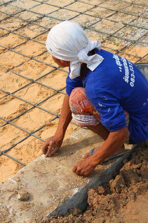 MUANG, BURIRAM - JANUARY 26 : Unidentified worker is working on construction site on January 26, 2013 at Taweekit Plaza Supermarket, Muang, Buriram, Thailand. Stock Photo - 17679317