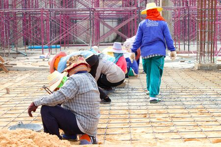 MUANG, BURIRAM - JANUARY 26 : Unidentified workers are working on construction site on January 26, 2013 at Taweekit Plaza Supermarket, Muang, Buriram, Thailand. Stock Photo - 17712716