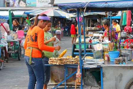 SATUK, BURIRAM - JANUARY 26 : Unidentified women are selling foods on January 26, 2013 at municipality market, Satuk, Buriram, Thailand.