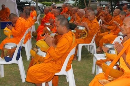 MUANG, MAHASARAKHAM - DECEMBER 5 : Unidentified monks are making religious merit and celebrating the king Rama IX birthday on December 5, 2012 at city hall ground, Muang, Mahasarakham, Thailand.