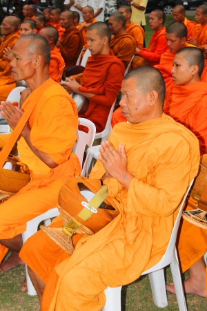 birthday religious: MUANG, MAHASARAKHAM - DECEMBER 5 : Unidentified monks are making religious merit and celebrating the king Rama IX birthday on December 5, 2012 at city hall ground, Muang, Mahasarakham, Thailand.