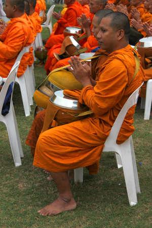 MUANG, MAHASARAKHAM - DECEMBER 5 : Unidentified monks are making religious merit and celebrating the king Rama IX birthday on December 5, 2012 at city hall ground, Muang, Mahasarakham, Thailand. Stock Photo - 17712796