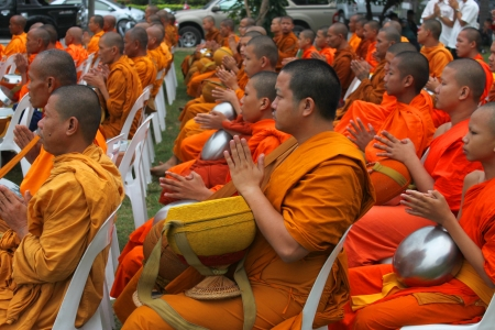 MUANG, MAHASARAKHAM - DECEMBER 5 : Unidentified monks are making religious merit and celebrating the king Rama IX birthday on December 5, 2012 at city hall ground, Muang, Mahasarakham, Thailand. Stock Photo - 17712803