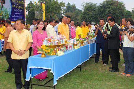 birthday religious: MUANG, MAHASARAKHAM - DECEMBER 5 : Mr.Noppawat Singhsakda, provincial governor and people are making religious merit and celebrating the king Rama IX birthday on December 5, 2012 at city hall ground, Muang, Mahasarakham, Thailand.