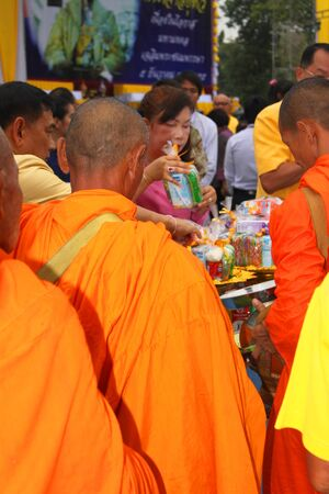 MUANG, MAHASARAKHAM - DECEMBER 5 : Unidentified monks are making religious merit, asking for alms  and celebrating the king Rama IX birthday on December 5, 2012 at city hall ground, Muang, Mahasarakham, Thailand. Stock Photo - 17712754