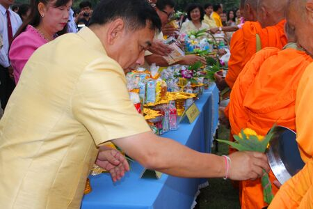 ix portrait: MUANG, MAHASARAKHAM - DECEMBER 5 : Mr.Noppawat Singhsakda, provincial governor and people are making religious merit, giving food offerings to Buddhist monks and celebrating the king Rama IX birthday on December 5, 2012 at city hall ground, Muang, Mahasar