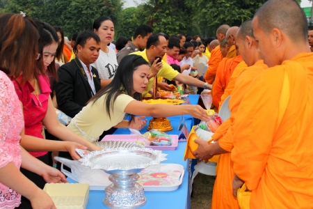 MUANG, MAHASARAKHAM - DECEMBER 5 : Unidentified people are making religious merit, giving food offerings to Buddhist monks and celebrating the king Rama IX birthday on December 5, 2012 at city hall ground, Muang, Mahasarakham, Thailand. Stock Photo - 17712775