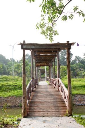 Wooden bridge and welcome entrance on October 14, 2012 at Pak Chong Floating Market, Korat, Thailand. Stock Photo - 17712819