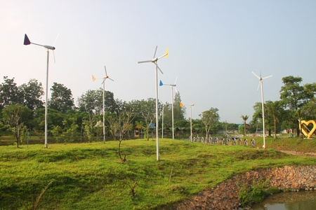 Wind turbines in garden and canal on October 14, 2012 at Pak Chong Floating Market, Korat, Thailand. Stock Photo - 17712824
