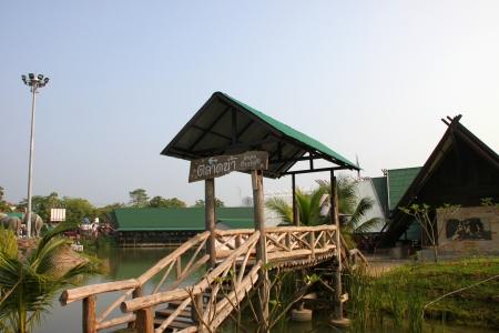 Wooden bridge and welcome entrance on October 14, 2012 at Pak Chong Floating Market, Korat, Thailand. Stock Photo - 17712834