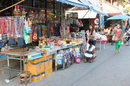 SAM CHUK, SUPHAN BURI - JANUARY 6 : Unidentified tourists are shopping in 100 years market on January 6, 2013 at old market by Tha Chin river(Talad Sam Chuk), Sam Chuk, Suphan Buri, Thailand. Stock Photo - 17712866