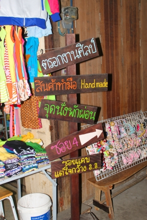 Welcome and promotion signs of 100 years market on January 6, 2013 at old market by Tha Chin river(Talad Sam Chuk), Sam Chuk, Suphan Buri, Thailand. Stock Photo - 17950123