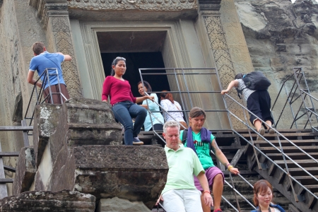 handscraft: SIEMREAP, KHMER REPUBLIC - FEBRUARY 24 : Unidentified tourists are going downstairs of classical Khmer construction on February 24, 2013 at Angkor Wat, Siemreap, Khmer Republic.