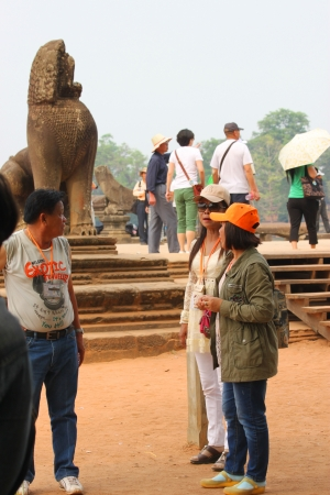 handscraft: SIEMREAP, KHMER REPUBLIC - FEBRUARY 24 : Unidentified tourists are visiting to classical Khmer construction on February 24, 2013 at Angkor Wat, Siemreap, Khmer Republic.