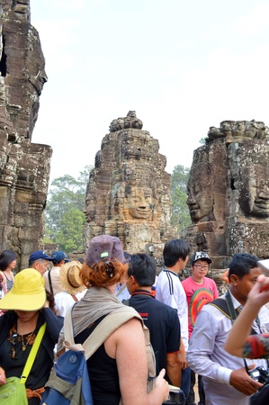 handscraft: SIEMREAP, KHMER REPUBLIC - FEBRUARY 24 : Unidentified tourists are visiting to classical Khmer construction on February 24, 2013 at The Bayon, Siemreap, Khmer Republic.