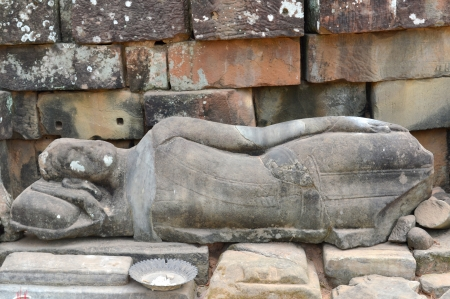 handscraft: Reclining Buddha stone carving of classical Khmer construction at The Bayon