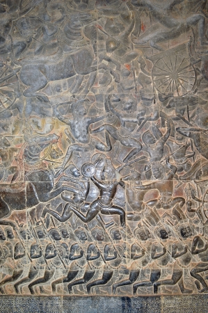 handscraft: Stone carving of classical Khmer construction at Angkor Wat, it was built both as the state temple and capital dedicated to Vishnu.