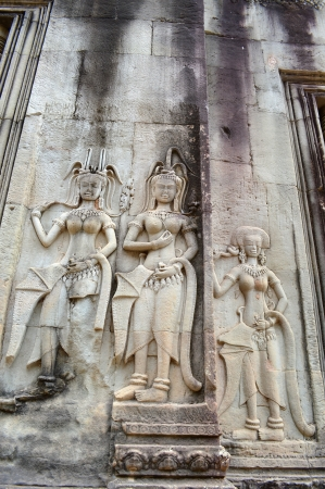 indo china: Stone carving of classical Khmer construction at Angkor Wat, it was built both as the state temple and capital dedicated to Vishnu.