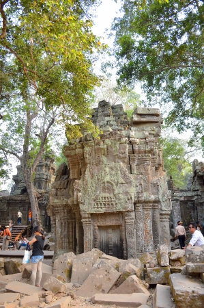 handscraft: SIEMREAP, KHMER REPUBLIC - FEBRUARY 24 : Unidentified tourists are visiting to classical Khmer construction on February 24, 2013 at Prasat Ta Prohm, Siemreap, Khmer Republic.