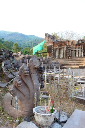Broken Naga heads on the ground at Prasat Vat Phou photo