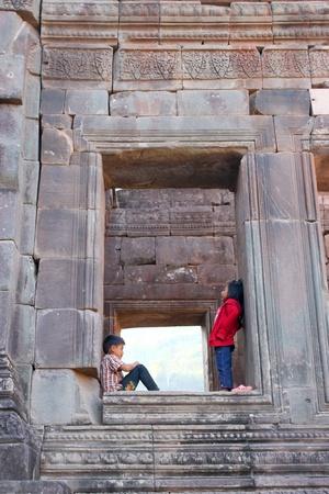 handscraft: CHAMPASAK, LAO P.D.R. - JANUARY 13 : Unidentified tourists are on window of classical construction on January 13, 2013 at Prasat Vat Phou, Champasak, Lao P.D.R.
