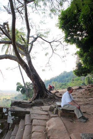 handscraft: CHAMPASAK, LAO P.D.R. - JANUARY 13 : Unidentified tourists are relax sitting in classical construction on January 13, 2013 at Prasat Vat Phou, Champasak, Lao P.D.R. Editorial