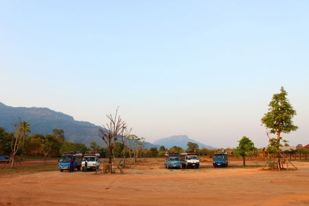 Bus and car parking at classical construction on January 13, 2013 at Prasat Vat Phou, Champasak, Lao P.D.R
