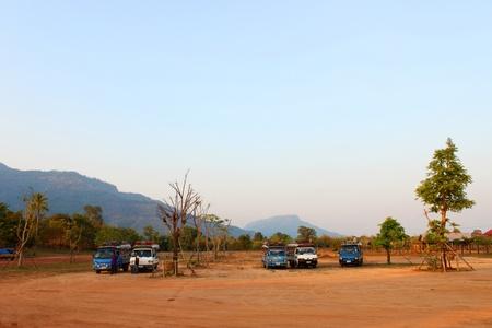handscraft: Bus and car parking at classical construction on January 13, 2013 at Prasat Vat Phou, Champasak, Lao P.D.R