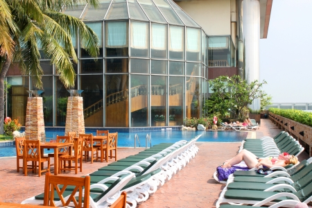BANGKOK, THAILAND - MARCH 19 : Unidentified tourists are relaxing by swimming pool on March 19, 2013 at Prince Palace Hotel, Boe Bae Tower, Bangkok, Thailand.