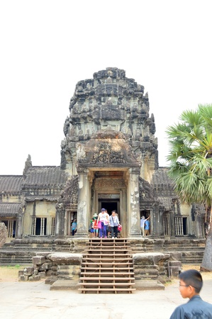 handscraft: SIEMREAP, KHMER REPUBLIC - FEBRUARY 24 : Unidentified tourists are visiting classical Khmer construction on February 24, 2013 at Angkor Wat, Siemreap, Khmer Republic.