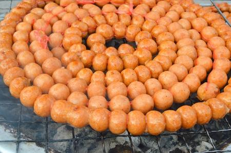 gridiron: grilled and smoked pork sausage balls on gridiron