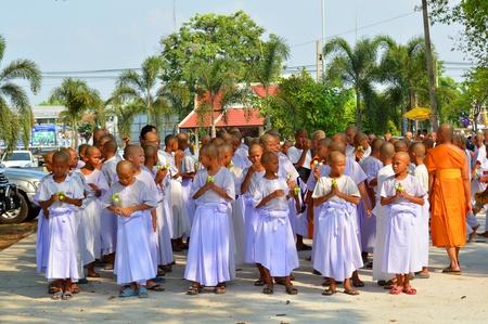 kinfolk: MUANG, MAHASARAKHAM - APRIL 10 : Unidentified boys are participating in summer ordination ceremony on April 10, 2013 at city hall plaza, Muang, Mahasarakham, Thailand.