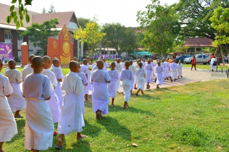 MUANG, MAHASARAKHAM - APRIL 10 : Unidentified boys are participating in summer ordination ceremony on April 10, 2013 at city hall plaza, Muang, Mahasarakham, Thailand. Stock Photo - 18951818