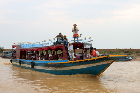 SIEMREAP, KHMER REPUBLIC - FEBRUARY 23 : The unidentified tourists are traveling by boat in the greatest freshwater lake in the world on February 23, 2013 at Tonle Sap Lake, Siemreap, Khmer Republic.