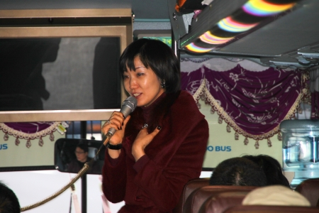 SEOUL, KOREA - NOVEMBER 26 : Unidentified Korea guide are talking to tourists on the bus on November 26, 2011 at Incheon Airport, Seoul, Korea.