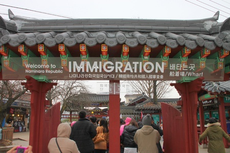 NAMINARA REPUBLIC, KOREA - NOVEMBER 26 : The unidentified tourists are visiting to attraction places on November 26, 2011 at Nami island, Naminara Republic, Korea. Stock Photo - 19075336