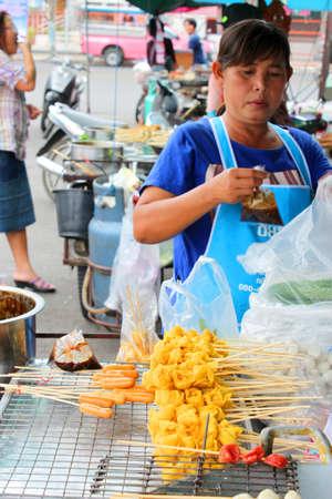 SATUK, BURIRAM - FEBRUARY 3 : Unidentified woman is selling foods on February 3, 2013 at municipality market, Satuk, Buriram, Thailand.