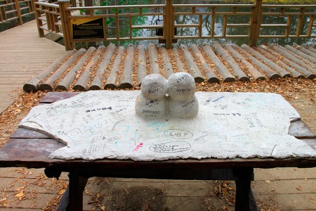 Snow statue tray of first kiss on wooden table on November 26, 2011 at Nami island, Naminara Republic, Korea.