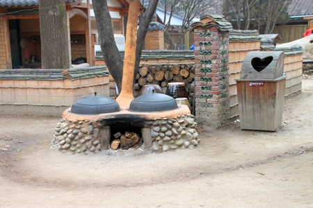 Old stoves and houses on November 26, 2011 at Nami island, Naminara Republic, Korea Stock Photo - 19298406