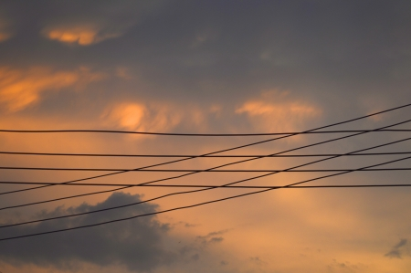electricity wire and sky background at sunset photo