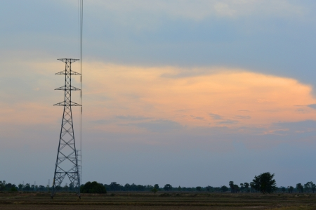 electricity tower and sky background at sunset photo