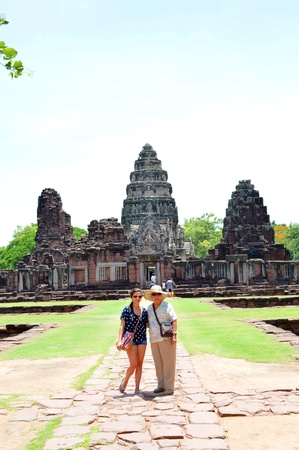 KORAT, THAILAND - JUNE 10 : Unidentified tourists are taken photograph for memory in front of Phimai sanctuary on June 10, 2013 in Korat, Thailand. Stock Photo - 20648491