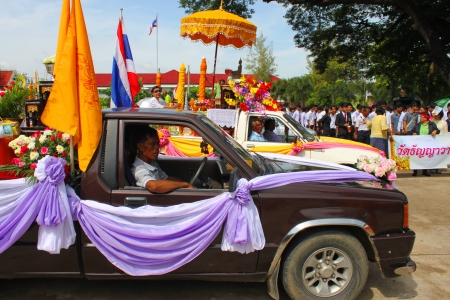 MAHASARAKHAM, THAILAND - JULY 19 : Unidentified people are participating in Buddhist Lent festival parade at city hall plaza on July 19, 2013 in Mahasarakham, Thailand.